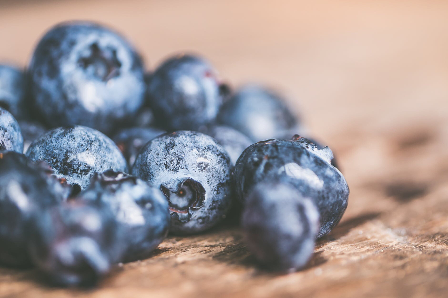 Close up of blueberries on a wooden table